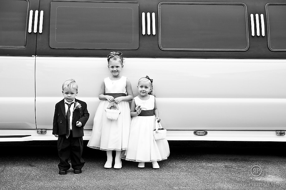 kids by a limo