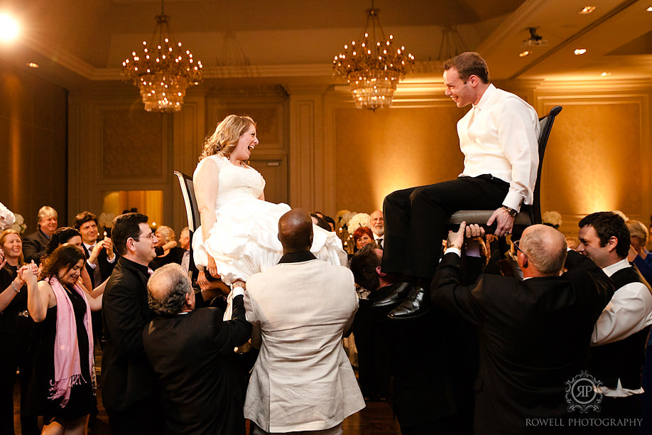 bride and groom on chairs jewish wedding traditions Shiri & Jon at Union Station & Hazelton Manor, Toronto Wedding