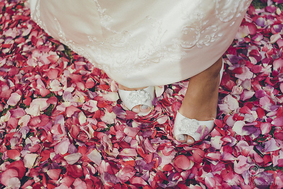 iceland wedding photographer ceremony flower petal aisle brides shoes Seljalandsfoss Iceland Wedding Photography