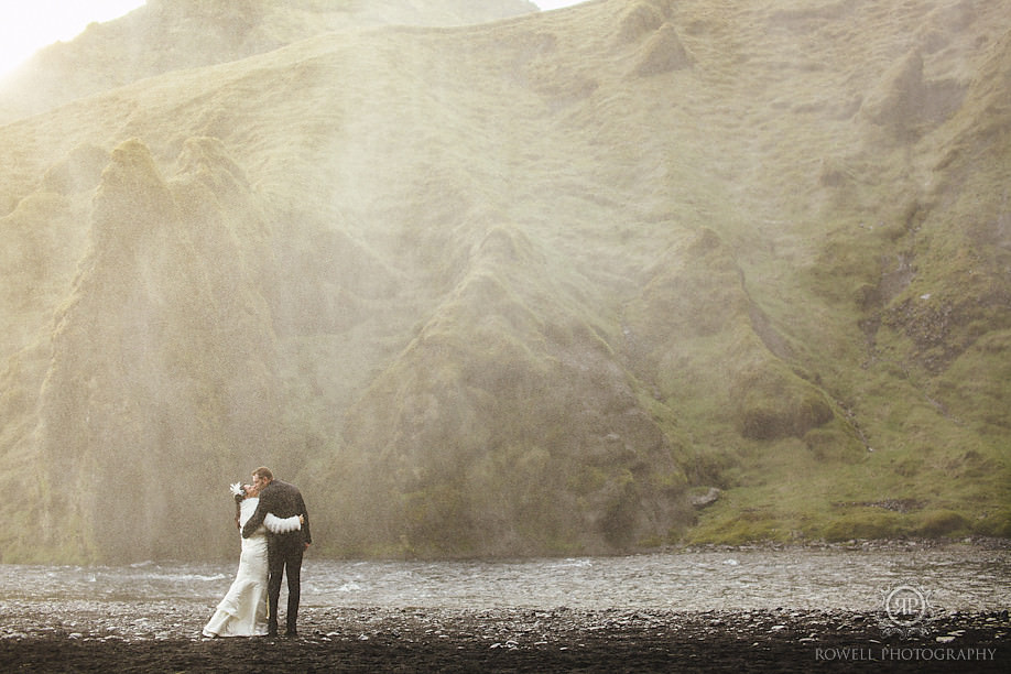 iceland wedding photographer romantic kiss at skogafoss Seljalandsfoss Iceland Wedding Photography