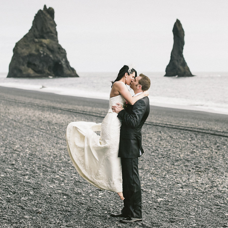 Ann & Chris kissing on the black sand beach of Vik Iceland