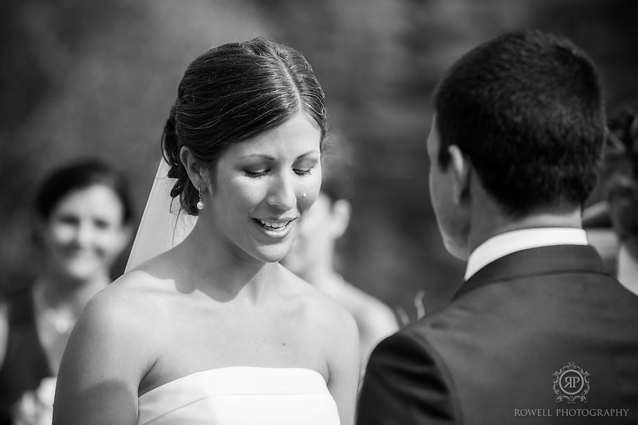 emotional bride during wedding vows Marcio & Lindsay   Windermere House Wedding