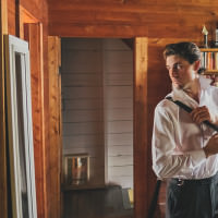 Muskoka photographer captures images of the groom getting ready at the cottage.