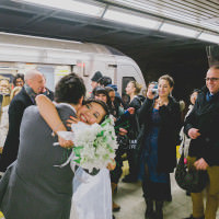 Toronto photographer captures unique wedding first look on Toronto subway.