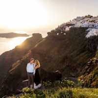 Santorini photographers capture a Greek sunset portrait on the Caldera.