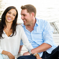 Muskoka photographer captures candid photos during a Muskoka engagement photo shoot on the dock.