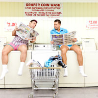 Canada photographer captures fun and quirky engagement photos in a laundry mat.