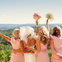 Quebec photographer captures bridesmaids looking out onto the Wakefield, Quebec Valley.