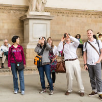 tourists taking photos in florence italy