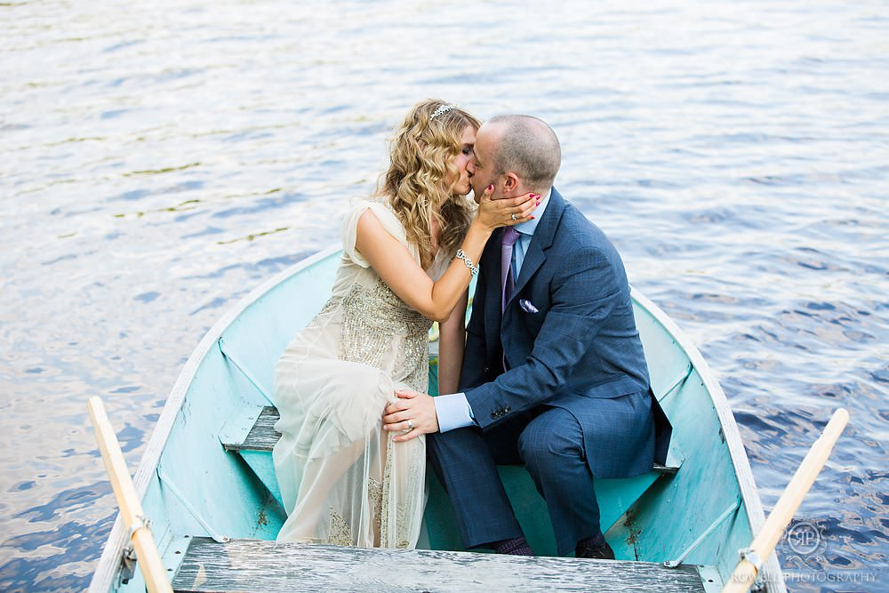 couple in a little boat algonquin weddings Killarney Lodge Wedding   Algonquin Park Canada