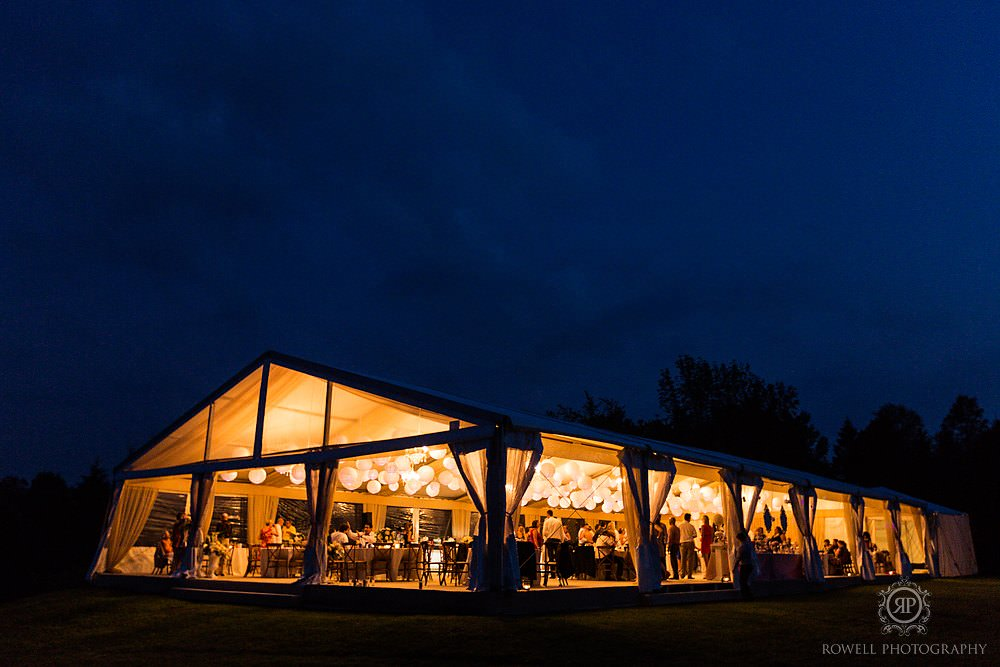 giant wedding tent at night Backyard Wedding