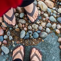 stones and feet on the beach nfld