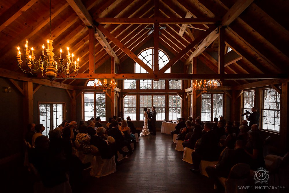 trillium resort muskoka winter wedding ceremony post beam Trillium Resort Muskoka   Winter Wedding