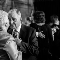 romantic old couple dancing at wedding
