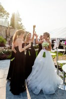 a romantic backyard wedding bride and bridesmaids celebrate with a toast