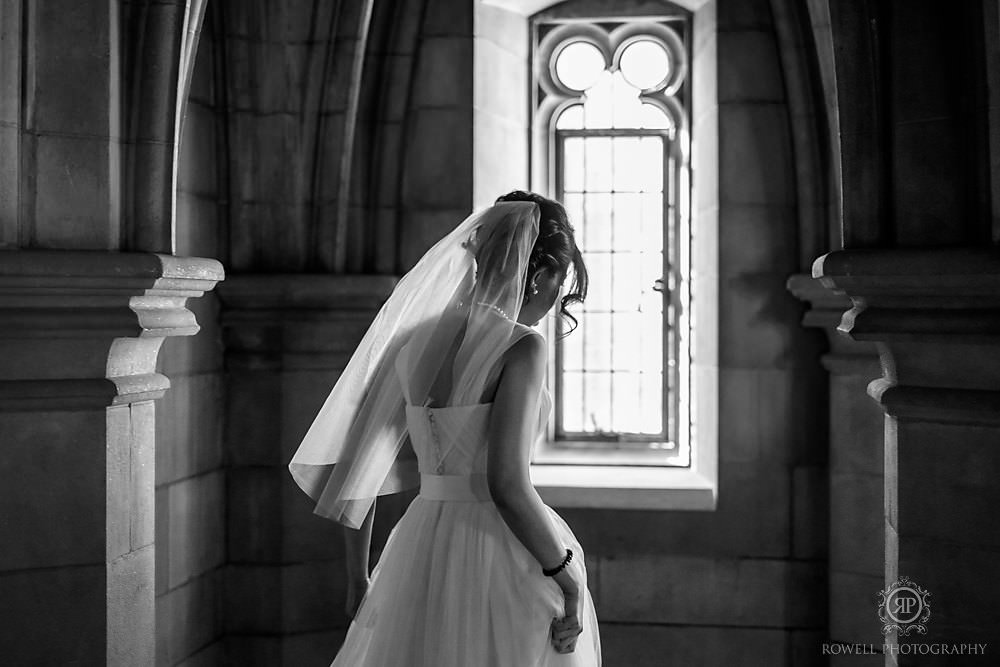 bride during her pre-wedding at knox college walking away in black and white