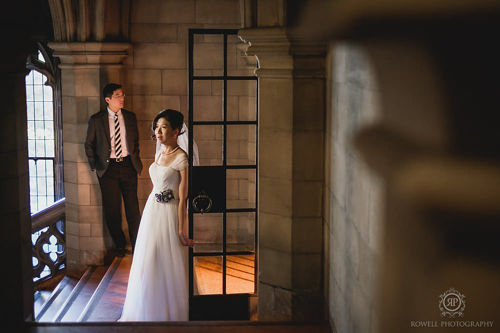 bride and groom standing at the entrance to knox college toronto's chapel
